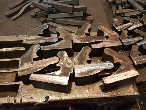 Flame Cut clamps being dressed